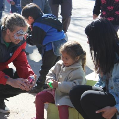 Projects Abroad volunteers interact with a child in Argentina during a community day at a local care centre.